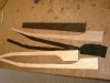 Here are the pieces of the guitar neck before they are laminated. The neck is made of Eastern Hard Rock Curly Maple, Dyed Black Holly Veneer and Western Curly Maple. The fret board is Ebony.