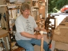 The wood pieces for the sides of the guitar are sprayed with water and heated while being bent by hand.